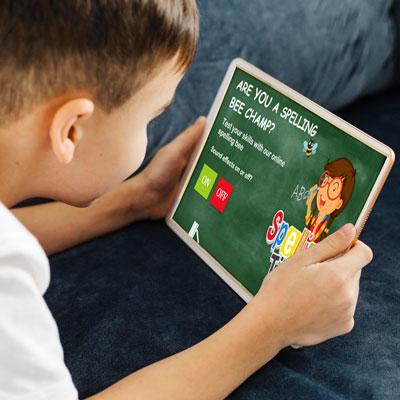 Boy on tablet doing spell test demo